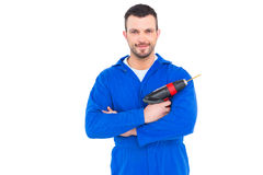 Confident handyman holding power drill Royalty Free Stock Photos