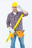Confident handyman holding spirit level Royalty Free Stock Photography