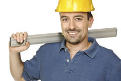 Confident handyman with spirit level royalty free stock image