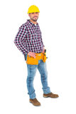 Confident handyman standing with hands on hips. Over white background Stock Images