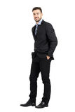 Confident happy business man with hands in pocket side view Royalty Free Stock Photo