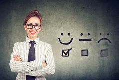 Confident happy business woman received excellent rating for a satisfaction survey stock images