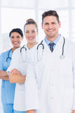 Confident happy group of doctors at medical office Stock Photo