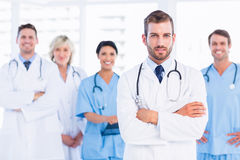 Confident happy group of doctors at medical office Stock Photos