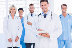 Confident happy group of doctors at medical office. Portrait of confident happy group of doctors standing at the medical office Stock Image