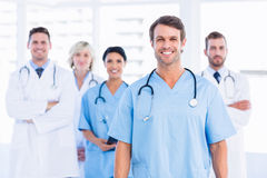 Confident happy group of doctors at medical office. Portrait of confident happy group of doctors standing at the medical office Royalty Free Stock Image