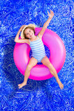 Confident happy little girl in a swimming pool Stock Images