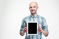 Confident happy man in checkered shirt holding blank screen tablet Stock Images