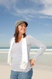 Confident happy mature woman at beach Stock Photo