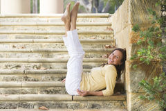 Confident happy mature woman legs up outdoor stock photo
