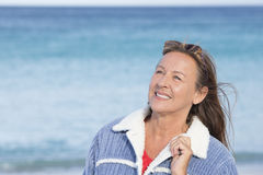 Confident happy mature woman ocean Royalty Free Stock Photos