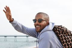 Free Confident Happy Young African-American Man Hipster In Sport Hoody And Sunglasses Looking A Friend On The Beach. Stock Photography - 118055832