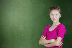 Confident happy, young student standing by chalkboard Royalty Free Stock Photo