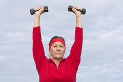 Confident healthy mature woman exercising Royalty Free Stock Images