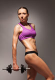 Confident healthy strong woman with dumbell Royalty Free Stock Photos