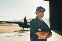 Confident helicopter pilot in uniform Stock Image