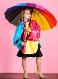 Confident in her fall garments. Waterproof accessories manufacture. Kid girl happy hold colorful umbrella wear. Waterproof cloak. Waterproof accessories make royalty free stock photos