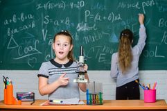 Confident at her researches. science experiments in chemistry laboratory. Biology lesson. Little girls in school lab. Chemistry education. Chemistry research royalty free stock images