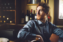 Confident hipster guy at the bar Stock Photos