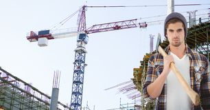 Confident hipster holding ax against crane Royalty Free Stock Photo