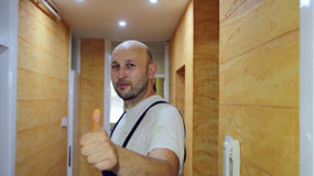 Confident House Painter Giving Thumb Up Stock Photo