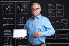 Confident intelligent man holding a tablet Royalty Free Stock Image