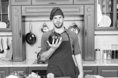 Confident at kitchen. Take old favorites and make healthful substitutions. Take favorite recipes and lighten them up. Man handsome chef holds violet cabbage royalty free stock photos