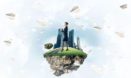 Confident lady boss and modern city as concept of eco green cons. Elegant confident businesswoman standing on green floating island in blue sky royalty free illustration