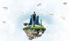 Confident lady boss and modern city as concept of eco green cons. Elegant confident businesswoman standing on green floating island in blue sky stock illustration