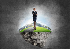 Confident lady boss and modern city as concept of eco green construction Royalty Free Stock Photography