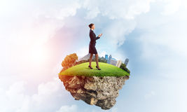 Confident lady boss and modern city as concept of eco green construction Royalty Free Stock Images