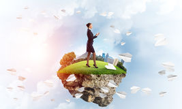 Confident lady boss and modern city as concept of eco green construction Stock Photography