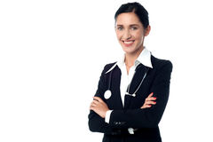 Confident lady doctor, arms crossed Stock Photos