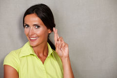 Confident lady expecting and crossing fingers Stock Photos