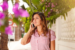 Confident lady listening to mobile phone outdoors Stock Photography
