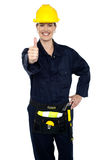 Confident lady worker showing thumbs up Stock Photography