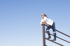 Confident laid back woman outdoor lookout Royalty Free Stock Photos