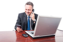 Confident lawyer talking on desk telephone Stock Image