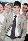 Confident leader. Portrait of smart businessman standing in front of his workteam Stock Photo