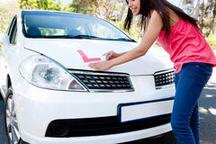 Learner driver happy. Confident learner driver girl proud of passing her test with car Royalty Free Stock Images