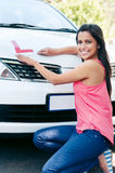 Learner driver happy. Confident learner driver girl proud of passing her test with car Stock Image