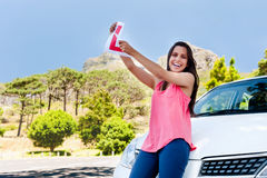 Learner driver happy. Confident learner driver girl proud of passing her test with car Stock Photo