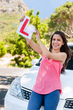 Learner driver happy. Confident learner driver girl proud of passing her test with car Royalty Free Stock Photos