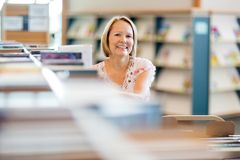 Confident Librarian Working In Library Stock Photos