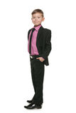 Confident little boy in a black suit Royalty Free Stock Image
