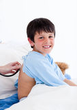 Confident little boy examined by a doctor Royalty Free Stock Photos