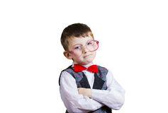 Confident little boy nerd isolated over yellow background. Royalty Free Stock Image