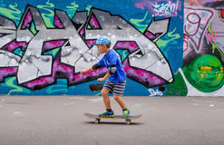 Confident little boy posing on his skateboard Stock Image