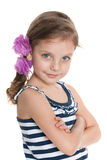 Confident little girl against the white background Royalty Free Stock Photos