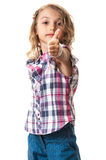 Confident little girl thumb up on white Stock Photos
